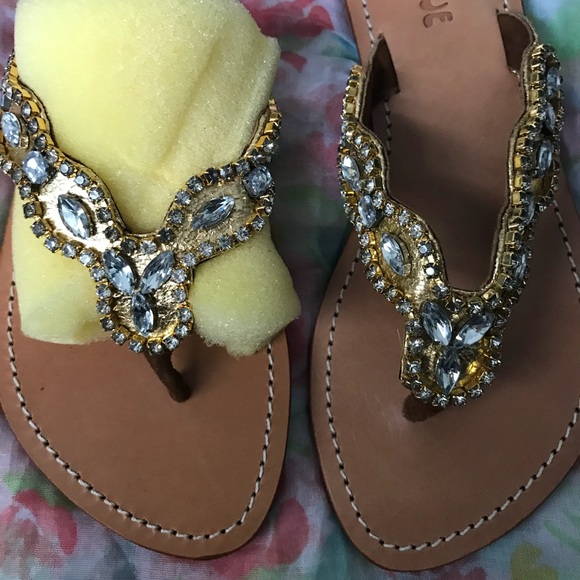 dfaebafb81e48e Mystique thong gold sandals with clear stones.